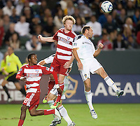 CARSON, CA – NOVEMBER 14: FC Dallas midfielders Marvin Chavez (18), Dax McCarty (13) and LA Galaxy defender Eddie Lewis (6) during the Western Conference Final soccer match at the Home Depot Center, November 14, 2010 in Carson, California. Final score LA Galaxy 0, Dallas FC 3.