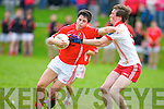 An Ghaeltacht's Caoimhghin O Beaglaoich and East Kerry's Liam Kearney in action in the minor County championship final at Killorglin on Saturday.