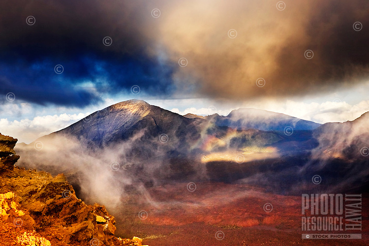 Haleakala crater seen at sunset through the passing clouds on Maui