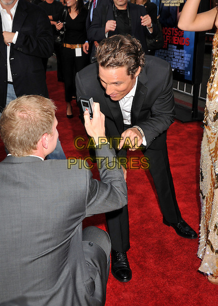 "MATTHEW McCONAUGHEY .""Ghosts Of Girlfriends Past"" Los Angeles Premiere held at Grauman's Chinese Theatre, Hollywood, California, USA..April 27th, 2009.half length black suit bending leaning gesture funny.CAP/ADM/BP.©Byron Purvis/AdMedia/Capital Pictures."