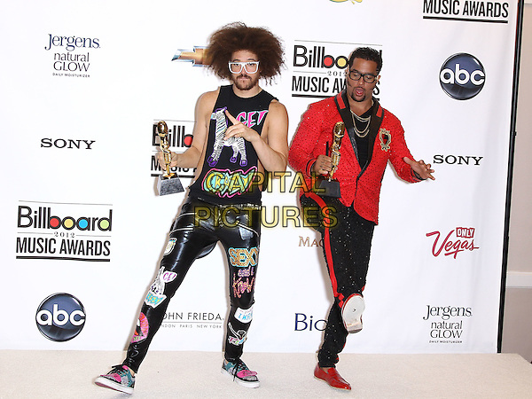 LMFAO - REDFOO (Stefan Gordy) & SKY BLU (Skyler Gordy) .2012 Billboard Music Awards Press Room at the MGM Grand Garden Arena Las Vegas, Las Vegas, Nevada, USA..May 20th, 2012.full length band group red jacket glasses black print hand arm in air devil gesture sign award trophy.CAP/ADM/MJT.© MJT/AdMedia/Capital Pictures.