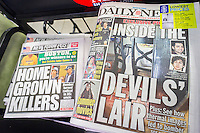 Newspapers at a newsstand in New York on Sunday, April 21, 2013 report on 19 year-old Dzhokhar Tsarnaev and his brother 26 year-old Tamerlan Tsarnaev, the alleged Islamic terrorists in the bombing at the finish line of the Boston Marathon on April 15. (© Richard B. Levine)