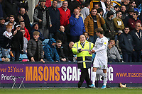 A Millwall steward escorts Patrick Bamford of Leeds to the away dug-out area after he was substituted in the second half and had to walk past the Millwall supporters during Millwall vs Leeds United, Sky Bet EFL Championship Football at The Den on 5th October 2019