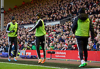 Sunday, 23 February 2014<br /> Pictured: Swansea City's Dwight Tiendalli warms up<br /> Re: Barclay's Premier League, Liverpool FC v Swansea City FC v at Anfield Stadium, Liverpool Merseyside, UK.