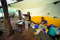 Algonquin Park, Ontario, Canada, July 2006. Sheltering from a summer thunderstorm at a little crow lake campsite. The Algonquin Provincial Park consists of many lakes that can be explored by canoe and which are connected by portages. Photo by Frits Meyst/Adventure4ever.com