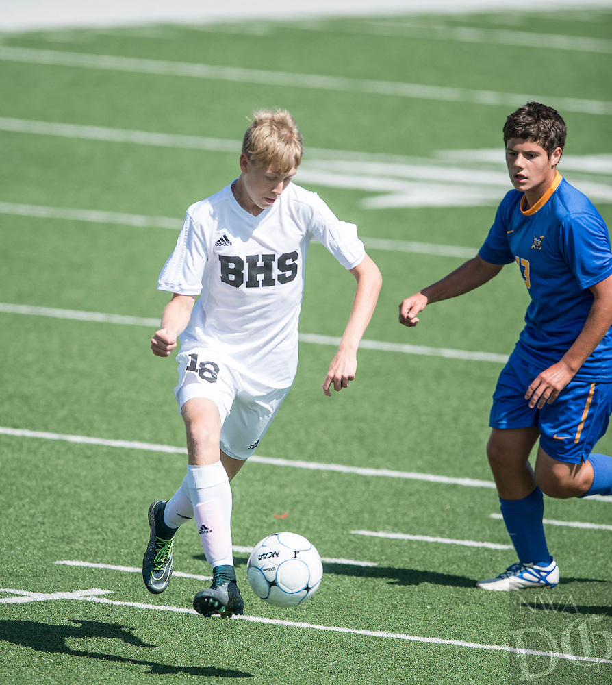 NWA Democrat-Gazette/ANTHONY REYES &bull; @NWATONYR<br /> Tyler Guentz, Bentonville sophomore, pushes up the pitch against North Little Rock Thursday, May 12, 2016 during the 7A state soccer tournament at Jarrell Williams Bulldog Stadium in Springdale. The Tigers won 7-0.