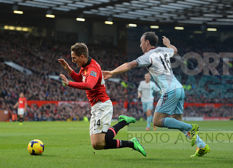 Adnan Januzaj of Manchester United goes down as he is challenged by Mark Noble of West Ham United - Barclays Premier League - Manchester Utd vs West Ham Utd - Old Trafford Stadium - Manchester - England - 21st December 2013  - Picture Simon Bellis/Sportimage
