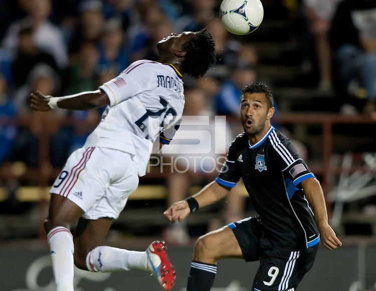 Santa Clara, California - Saturday July 14, 2012: Real Salt Lake's Kenny Mansally heads the ball while San Jose Earthquakes' Sercan Guvenisk eyes for the ball during a game at Buck Shaw Stadium, Stanford, Ca     San Jose Earthquakes defeated Real Salt Lake 5 - 0
