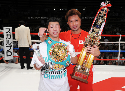 (L-R) Akira Yaegashi (JPN),  Koji Matsumoto,<br /> AUGUST 12, 2013 - Boxing :<br /> Akira Yaegashi of Japan celebrates with his trainer Koji Matsumoto after winning the WBC flyweight title bout at Ota-City General Gymnasium in Tokyo, Japan. (Photo by Mikio Nakai/AFLO)