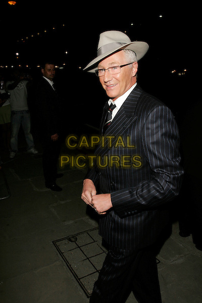 "PAUL O'GRADY.The ""Sex And The City: The Movie"" afterparty, Old Billingsgate Market, London, England, UK.May 12th, 2008.after party SATC half length black pinstripe suit beige fedora trilby hat glasses .CAP/AH.©Adam Houghton/Capital Pictures."