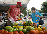 NWA Democrat-Gazette/BEN GOFF @NWABENGOFF<br /> Adrian Leffingwell, manager of Cobblestone Farm in Fayetteville, sells peppers to Henrietta Martinez of Bella Vista on Saturday Aug, 27, 2016 during the Bentonville Farmers Market on the Bentonville square.