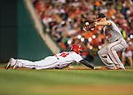 25 August 2016: Baltimore Orioles first baseman Chris Davis catches a pick-off attempt to get Bryce Harper out during a game against the Washington Nationals at Nationals Park in Washington, DC. The Nationals blanked the Orioles 4-0 to salvage one game of their 4-game home and away series. Mandatory Credit: Ed Wolfstein Photo *** RAW (NEF) Image File Available ***