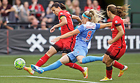 Portland, Oregon - Wednesday June 22, 2016: Portland Thorns FC forward Christine Sinclair (12) shoots in front of Chicago Red Stars defender Julie Johnston (8) during a regular season National Women's Soccer League (NWSL) match at Providence Park.