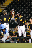 Bradenton Marauders first baseman Jose Osuna (24) fist bumps Erich Weiss (6) after a home run during a game against the Charlotte Stone Crabs on April 22, 2015 at McKechnie Field in Bradenton, Florida.  Bradenton defeated Charlotte 7-6.  (Mike Janes/Four Seam Images)