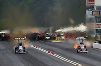 Aug. 3, 2013; Kent, WA, USA: NHRA top fuel dragster driver Shawn Langdon (left) races alongside Spencer Massey during qualifying for the Northwest Nationals at Pacific Raceways. Mandatory Credit: Mark J. Rebilas-USA TODAY Sports
