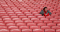 An Arsenal fan enjoys the peace and quiet before kick off<br /> <br /> Photographer David Shipman/CameraSport<br /> <br /> The Premier League - Arsenal v Burnley - Saturday 22nd December 2018 - The Emirates - London<br /> <br /> World Copyright © 2018 CameraSport. All rights reserved. 43 Linden Ave. Countesthorpe. Leicester. England. LE8 5PG - Tel: +44 (0) 116 277 4147 - admin@camerasport.com - www.camerasport.com