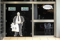 "Pictured: A poster of Sir Philip Green on the door of the now closed down BHS store in Oxford Street, Swansea, Wales, UK. Tuesday 13 September 2016<br /> Re: Former owner of BHS, Sir Philip Green has paid a surprise 'visit' to the closed down BHS store in Swansea.<br /> He was spotted in the doorway of the Oxford Street store, which closed its doors for the last time last month.<br /> In his hand was a BHS shopping bag with money spilling out of it.<br /> Sir Philip had owned BHS before selling it for £1 last year.<br /> He is claimed to have taken millions out of the company in dividends and left behind a £571m pensions deficit.<br /> Alongside the poster are the words: ""Thankyou for your custom Sir""."