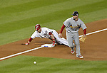 12 October 2012: Washington Nationals rookie outfielder Bryce Harper slides into third with an RBI triple, scoring Jayson Werth, in the first inning of Postseason Playoff Game 5 of the National League Divisional Series against the St. Louis Cardinals at Nationals Park in Washington, DC. The Cardinals rallied with four runs in the 9th inning to defeat the Nationals 9-7; thus winning the NLDS and moving on to the NL Championship Series. Mandatory Credit: Ed Wolfstein Photo