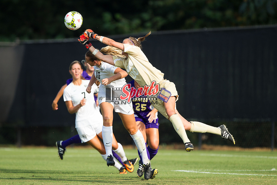 James Madison Dukes goalie Ellen Forrest (00) punches the ball away from Kim Marshall (10) of the Wake Forest Demon Deacons at Spry Soccer Stadium on August 29, 2014 in Winston-Salem, North Carolina.  The Dukes defeated the Demon Deacons 2-1.   (Brian Westerholt/Sports On Film)