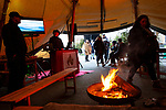 BRUSSELS - BELGIUM - 30 November 2018 -- Christmas market in Brussels features a specialty: the Finnish Village. -- Warming up at  the open fire in the Lapland tent. -- PHOTO: Juha ROININEN / EUP-IMAGES