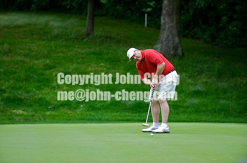 06/24/09 - Photo by John Cheng for Newsport.  USA Gymnastics President Steve Penny attempts a putt at the Travelers Championship at the TPC River Highlands in Cromewll Connecticut.