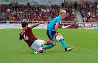 Kyle Dempsey of Fleetwood Town is tackled by Yaser Kasim of Northampton Town during the Sky Bet League 1 match between Northampton Town and Fleetwood Town at Sixfields Stadium, Northampton, England on 12 August 2017. Photo by Alan  Stanford / PRiME Media Images.