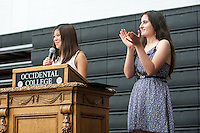 From left, Megan Sumida '14 and Larissa Saco '14 during Senior Brunch and Class Day, May 16, 2014 in Rush Gym. (Photo by Marc Campos, Occidental College Photographer)