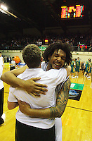 Tall Blacks forward BJ Anthony hugs strength and conditioning coach Claire Dallison after the win during the International basketball match between the NZ Tall Blacks and Australian Boomers at TSB Bank Arena, Wellington, New Zealand on 25 August 2009. Photo: Dave Lintott / lintottphoto.co.nz