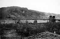 BNPS.co.uk (01202 558833)<br /> NARA/BNPS<br /> <br /> The Ludendorff Railroad Bridge spanned the Rhine River from Remagen to the eastern side of the river. <br /> <br /> Remarkable rarely seen photos of heroic Allied soldiers fighting their way across Europe before crossing the River Rhine 75 years ago feature in a new book.<br /> <br /> They are published in Images of War, Montgomery's Rhine Crossing, which tells the story of the legendary offensive, nicknamed Operation Plunder, in March 1945.<br /> <br /> On the night of March 23, Field Marshal Bernard Montgomery's 21st Army Group launched a massive artillery, amphibious and airborne assault to breach the historic defensive water barrier protecting northern Germany.<br /> <br /> At the same time, the Americans, with the support of the British 6th Airborne Division, set in motion Operation Varsity - involving 16,000 paratroopers - on the east bank of the Rhine. They were dropped here to seize bridges to prevent German reinforcements from contesting the bridgeheads.<br /> <br /> Fierce fighting ensued, with much bloodshed on both sides as the Allies met determined resistance from machine gun nests. But the daring operation proved successful, helping to considerably shorten the war - the Nazis surrendered just six weeks later.