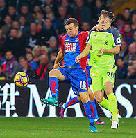 James McArthur of Crystal Palace challenges Adam Lallana of Liverpool during the EPL - Premier League match between Crystal Palace and Liverpool at Selhurst Park, London, England on 29 October 2016. Photo by Steve McCarthy.