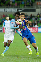 Melbourne, 10 November 2016 - BRUCE KAMAU (11) of Melbourne City and IVAN VUJICA (13) of the Jets fight for the ball in the round 6 match of the A-League between Melbourne City and Newcastle Jets at AAMI Park, Melbourne, Australia. Melbourne won 2-1 (Photo Sydney Low / sydlow.com)