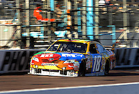 Apr 17, 2009; Avondale, AZ, USA; NASCAR Sprint Cup Series driver Kyle Busch during qualifying for the Subway Fresh Fit 500 at Phoenix International Raceway. Mandatory Credit: Mark J. Rebilas-