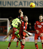 Crawley Town's Mark Connolly beats Exeter City's Ollie Watkins to the header during the Sky Bet League 2 match between Crawley Town and Exeter City at Broadfield Stadium, Crawley, England on 28 February 2017. Photo by Carlton Myrie / PRiME Media Images.