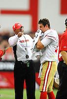 Sept. 13, 2009; Glendale, AZ, USA; San Francisco 49ers head coach Mike Singletary with quarterback Shaun Hill against the Arizona Cardinals at University of Phoenix Stadium. San Francisco defeated Arizona 20-16. Mandatory Credit: Mark J. Rebilas-