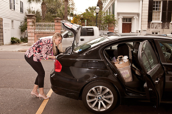November 27, 2012. Charleston, South Carolina.. Alexa Wyatt loads wedding items into her BMW. The bride for the weekend's wedding has brought her items to be brought to the reception location.. Alexa Wyatt, 23, is an Event Coordinator with Southern Protocol, a boutique wedding and event planning company in Charleston, SC..