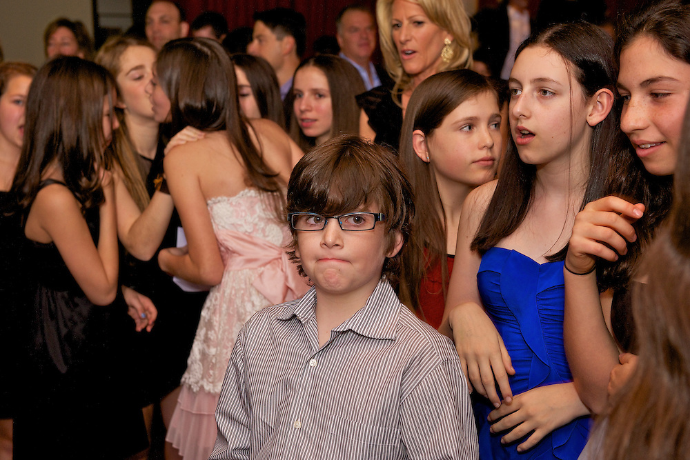 The Bat Mitzvah girl's baby brother on the dance floor.