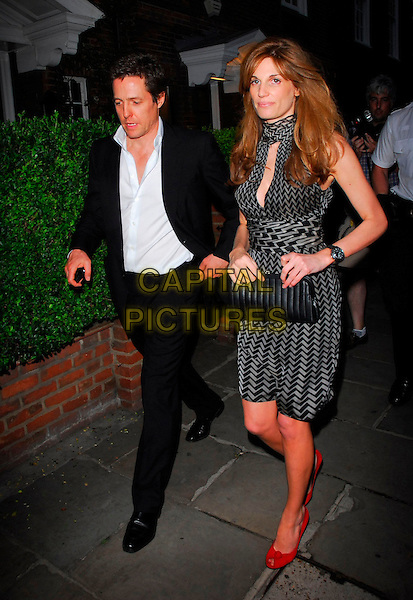 JEMIMA KHAN & HUGH GRANT.Sir David Frost Summer Party, Carlyle Square, London, UK..July 5th, 2006.Ref: CAN.full length black suit grey gray pattern dress couple clutch purse red shoes.www.capitalpictures.com.sales@capitalpictures.com.©Capital Pictures