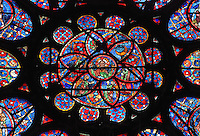 Central section of the Rose window of the North transept, c. 1240, with God the Father surrounded by the sun, moon and angels, in the Cathedrale Notre-Dame de Reims or Reims Cathedral, Reims, Champagne-Ardenne, France. The cathedral was built 1211-75 in French Gothic style with work continuing into the 14th century, and was listed as a UNESCO World Heritage Site in 1991. Picture by Manuel Cohen