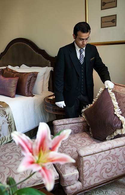 MUMBAI, INDIA - SEPTEMBER 27, 2010:  A morning suited butler attends to a Club room in the heritage wing of the Taj Mahal Palace and Tower Hotel in Mumbai. The Hotel has re-opened after the terror attacks of 2008 destroyed much of the heritage wing. The wing has been renovated and the hotel is once again the shining jewel of Mumbai. pic Graham Crouch