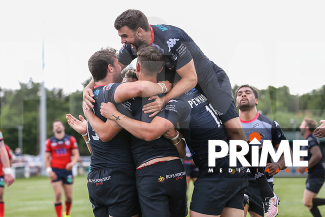 Alex Walker of London Broncos celebrates with team mates after he scores his try during the Kingstone Press Championship match between London Broncos and Featherstone Rovers at Castle Bar , West Ealing , England  on 25 June 2017. Photo by David Horn.