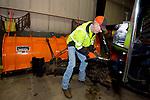 MIDDLEBURY, CT-011719JS04- Marc Camputaro with Middlebury Public Works, attaches hydraulic hoses from the plow to his truck Thursday at the town garage as workers prepare for any weather we might receive over the weekend.  Jim Shannon Republican American
