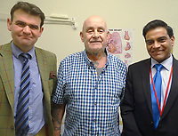 PLEASE BYLINE ABMU HEALTH BOARD/ATHENA PICTURES<br /> Pictured: Peter Maggs (C) with Thomas Bragg (L) and Ira Goldsmith (R) <br /> Re: A man has had his chest rebuilt using 3D printing technology during an operation to remove a large tumour.<br /> The prosthesis was inserted into Peter Maggs' chest after he had three ribs and half his breastbone removed.<br /> The tumour had grown to around the size of a tennis ball, and the procedure left an extensive defect in the 71-year-old's chest.<br /> The eight-hour operation was carried out by surgeons at Morriston Hospital, Swansea.<br /> Surgeons would traditionally have rebuilt it with a special cement prosthesis.<br /> But advances in 3D printing technology allowed them to use a bespoke implant instead.<br /> It is believed to be one of the first times such an implant has been printed in the UK.<br /> The titanium implant was designed at Morriston and printed in Wales.<br /> &quot;It was a very extensive growth that needed to be removed. However, removing it also meant removing part of the breastbone and three ribs,&quot; cardiothoracic surgeon Ira Goldsmith said.<br /> &quot;That would leave a large defect that could have destabilised the entire chest wall and reconstructing it was going to be a very complex procedure,&quot; he added.