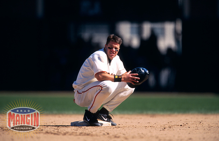 SAN FRANCISCO, CA - J.T. Snow of the San Francisco Giants sits on second base during a break in the action during a game against the Milwaukee Brewers at Pacific Bell Park in San Francisco, California on April 21, 2001. Photo by Brad Mangin