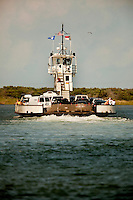A ferry boat loaded with cars sets sail for Ocracoke Island. The island's ferry-only access adds to the island's romantic feel (it can also be reached by private boat or private plane). Ocracoke Island, in Hyde County North Carolina, is one of the most remote islands in the Outer Banks. The island's economy is based almost entirely on tourism. . Charlotte NC photographer Patrick Schneider has extensive photo collections of the following lighthouses: Bodie Island Lighthouse, Bald Head Island Lighthouse, Cape Fear Lighthouse, Cape Hatteras Lighthouse, Cape Lookout Lighthouse, Currituck Beach Lighthouse, Diamond Shoal Lighthouse, Federal Point Lighthouse, Oak Island Lighthouse, and Ocracoke Lighthouse on Ocracoke Island.