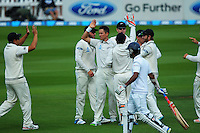 Trent Boult celebrates dismissing Dimuth Karunaratne during day one of the 2nd cricket test match between the New Zealand Black Caps and Sri Lanka at the Hawkins Basin Reserve, Wellington, New Zealand on Saturday, 3 February 2015. Photo: Dave Lintott / lintottphoto.co.nz