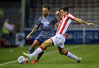 Lincoln City's Neal Eardley vies for possession with Stoke City's Jack Dunwoody<br /> <br /> Photographer Chris Vaughan/CameraSport<br /> <br /> Football Pre-Season Friendly - Lincoln City v Stoke City - Wednesday July 24th 2019 - Sincil Bank - Lincoln<br /> <br /> World Copyright © 2019 CameraSport. All rights reserved. 43 Linden Ave. Countesthorpe. Leicester. England. LE8 5PG - Tel: +44 (0) 116 277 4147 - admin@camerasport.com - www.camerasport.com