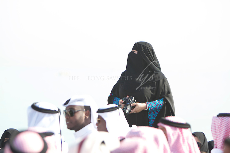 Qatari Lady capturing the images of her National Day celebration, Doha, Qatar | Dec 10
