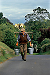 John Blackwell for over 50 years he has collected water each day at 4pm from the River Leach. He does not trust tap water in his home and prefers to do what he and his family have always done. Eastleach Turville Gloucestershire 1993. 1990s UK