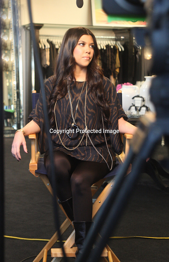 .1-13-10   January 13th 2010...Kourtney Kardashian & Scott Disick went to the family clothing store Dash in Calabasas California  for a live interview with Jay Leno. . Kourtney's  boyfriend spent most of the time text messaging on his phone during the 5 minute interview. After the interview was over Kourtney looked through some of the clothing inside the shop & hugged up with her boyfriend. About ten fans waited outside the store watching the interview and taking pictures. Everyone outside was laughing at her hair and makeup stylist who looked more like an NFL  football player....AbilityFilms@yahoo.com.805-427-3519.www.AbilityFilms.com.