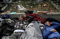 Pictured: Men sleep on the ground in Victoria Square, Athens Monday 29 February 2016<br /> Re: Hundreds of migrants have been living in Victoria Square in central Athens Greece